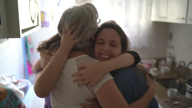 family girls embracing at home - gratitude stock videos & royalty-free footage