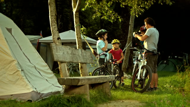 family going cycling - camping stock videos and b-roll footage