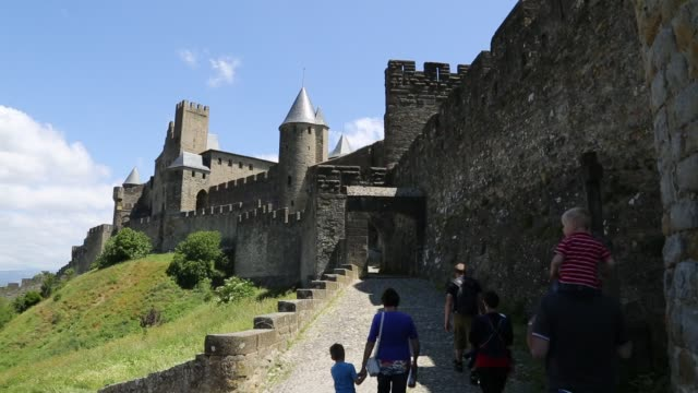 family going into cité de carcassonne - carcassonne stock videos and b-roll footage