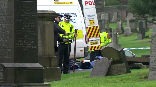 a family grave in scotland is to be exhumed in a bid to solve a 56 yearold murder mystery police will dig up the grave at old monklands cemetery in... - gebot stock-videos und b-roll-filmmaterial