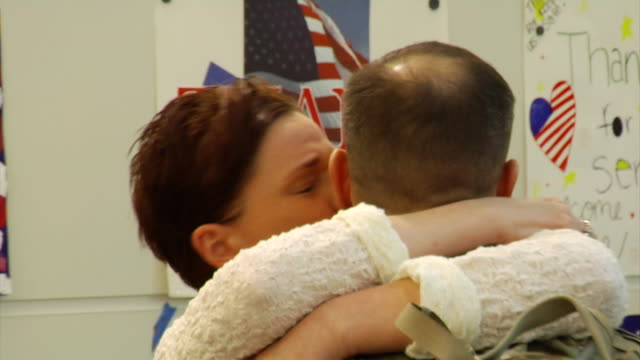family greets soldier returning from war on march 21, 2012 in baltimore, md - ホームカミング点の映像素材/bロール