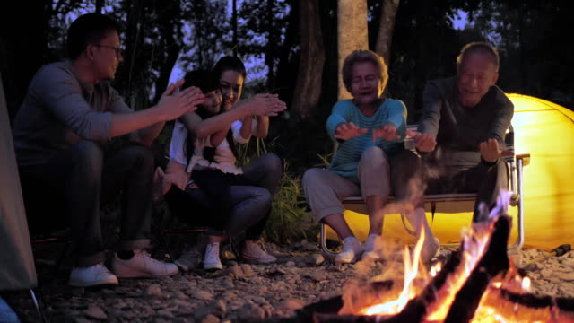 family, happiness, generation, vacation and people concept - the family is happy to outdoor camping activities. - camping stock videos & royalty-free footage