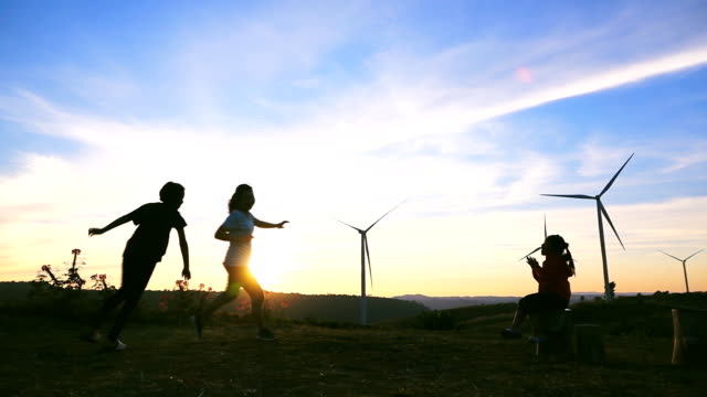 hd slow motion: family happy at hill with sunset - alternative energy stock videos and b-roll footage