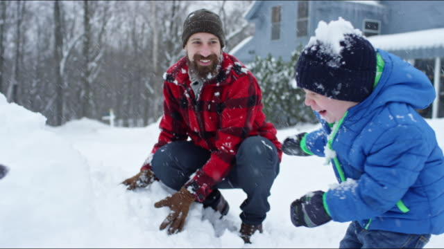 family having a snowball fight on a vermont winter's day. - vermont stock videos & royalty-free footage