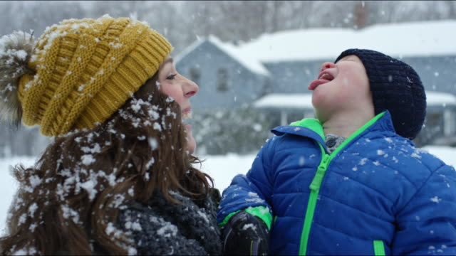 family having a snowball fight on a vermont winter's day. - woolly hat stock videos and b-roll footage