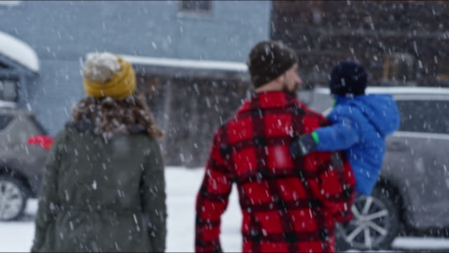 family having a snowball fight on a vermont winter's day. - sunday stock-videos und b-roll-filmmaterial