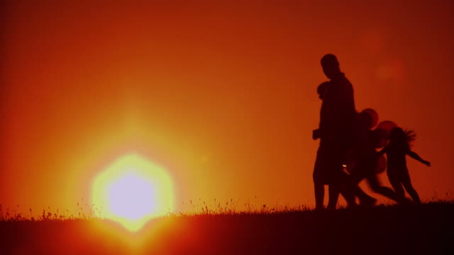 HD: Family Having A Walk At Sunset