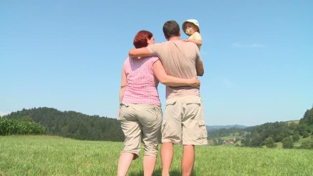 hd crane: family having a walk - crane shot stock videos & royalty-free footage
