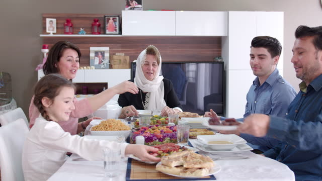 family having an iftar meal - middle eastern ethnicity stock videos & royalty-free footage
