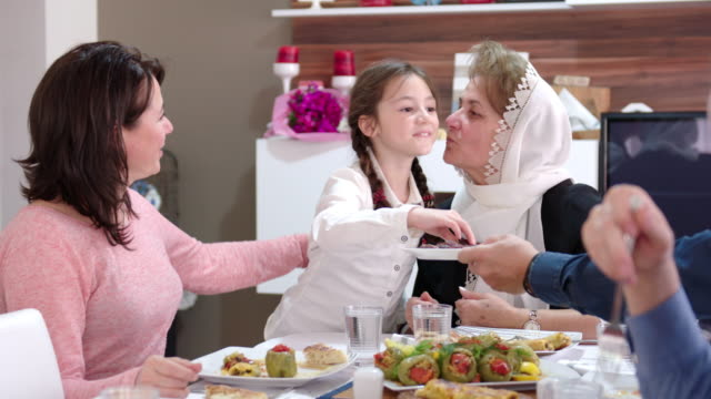family having an iftar meal - islam stock videos & royalty-free footage