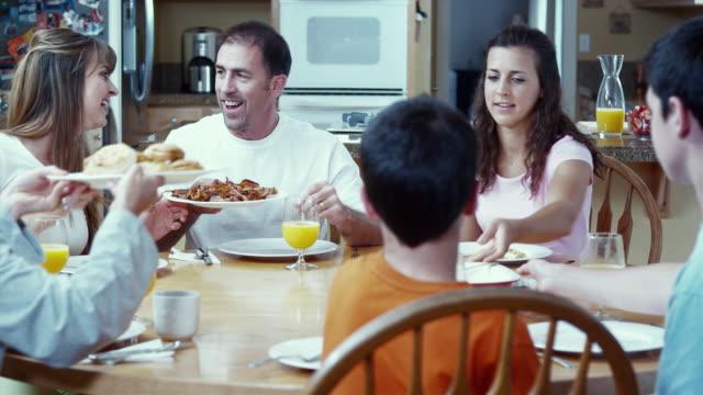 MS PAN Family having breakfast at table / Renton, Washington, USA