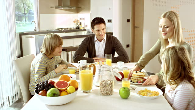 family having breakfast together - juice drink stock videos & royalty-free footage