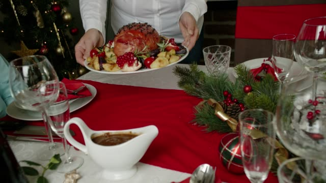 family having christmas dinner with glazed holiday ham with cloves, vegetables, minced pies and eggnog orange trifle - ornate stock videos & royalty-free footage