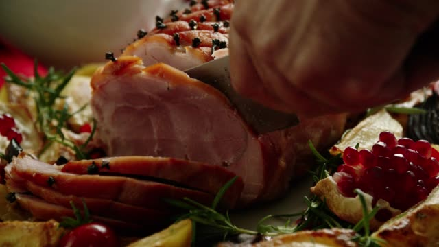 family having christmas dinner with glazed holiday ham with cloves, vegetables, minced pies and eggnog orange trifle - christmas decoration stock videos & royalty-free footage