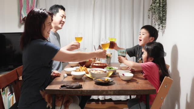 family having dinner at home - dining table stock videos & royalty-free footage