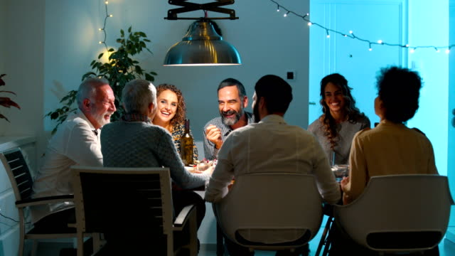 family having dinner on christmas eve 4k - dinner party stock videos & royalty-free footage