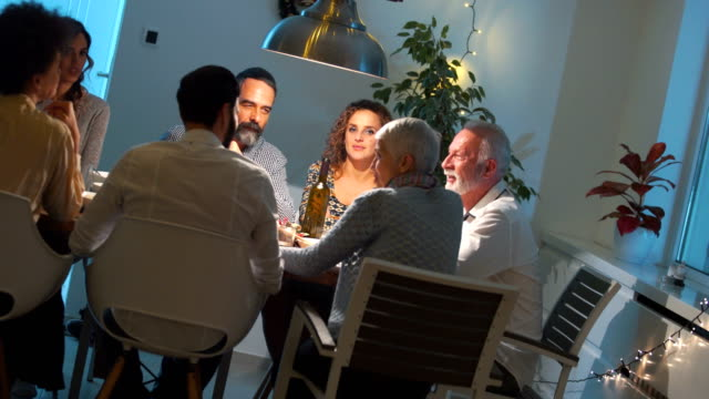 family having dinner on christmas eve. - dinner party stock videos & royalty-free footage