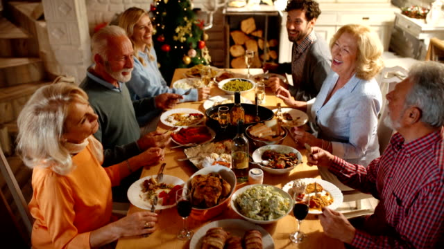 family having dinner on christmas eve. - meal stock videos & royalty-free footage