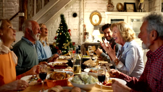 family having dinner on christmas eve. - christmas stock videos & royalty-free footage