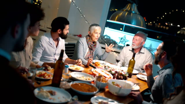 family having dinner on christmas eve. - roast dinner stock videos & royalty-free footage