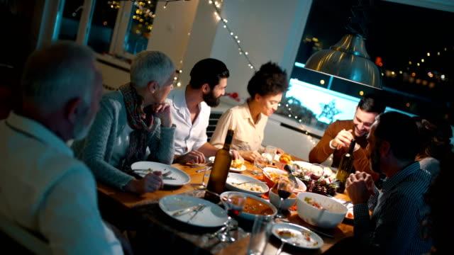 family having dinner on christmas eve. - persona di sangue misto video stock e b–roll