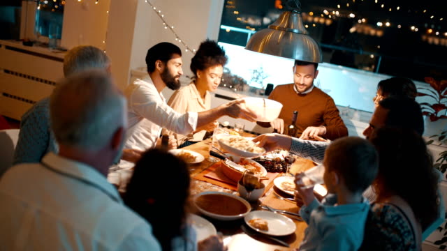 family having dinner on christmas eve. - public celebratory event stock videos & royalty-free footage