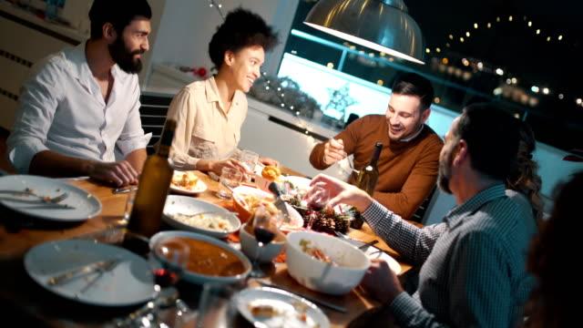 family having dinner on christmas morning. - quarantenne video stock e b–roll