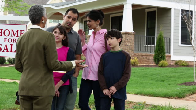 WS DS Family Having Discussion with Realtor in Front of New Home For Sale / Richmond, Virginia, USA