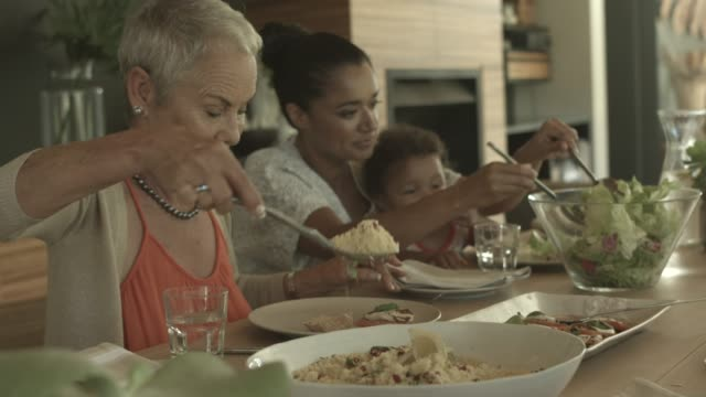 family having food during reunion - social gathering stock videos & royalty-free footage
