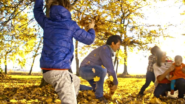 slo mo family having fun in the autumn - family with three children stock videos & royalty-free footage