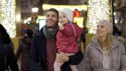 Family having fun in the city during holidays