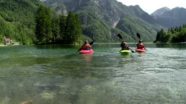hd: family having fun kayaking on the lake - family with one child stock videos & royalty-free footage