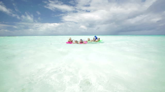 family having fun on airbeds - inflatable raft stock videos and b-roll footage