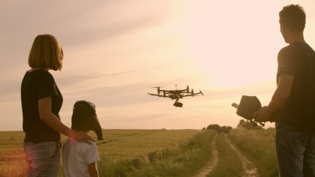 WS Family having fun playing with a drone