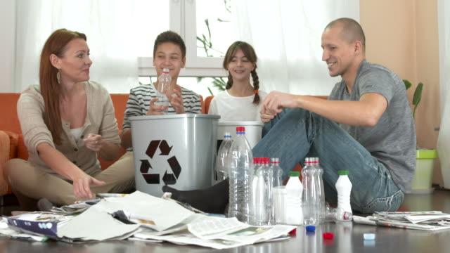 HD DOLLY: Family Having Fun Recycling At Home