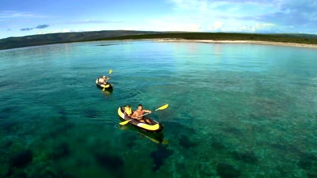 aerial family having fun sea kayaking - canoeing stock videos & royalty-free footage