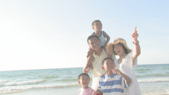 Family having fun time on shore