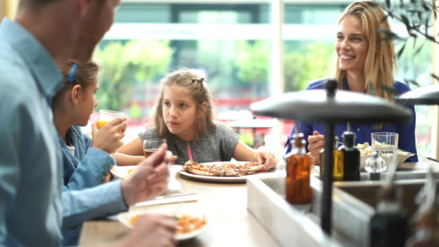 family having lunch at a restaurant. - cucina mediterranea video stock e b–roll