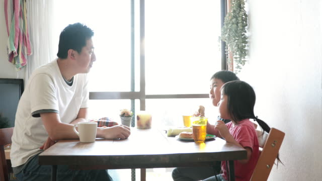 family having lunch at home - genderblend stock videos & royalty-free footage