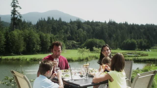 MS DS Family having lunch in outdoor restaurant / Squamish, British Columbia, Canada