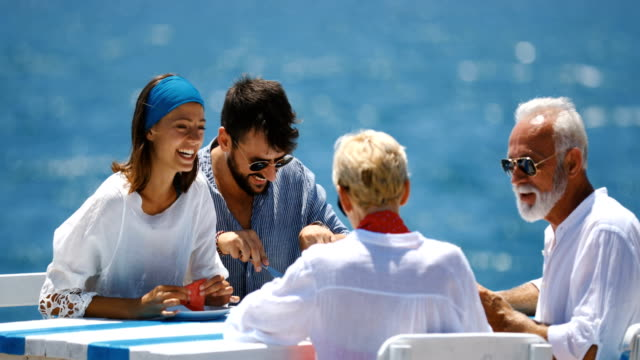 family having lunch outdoors. - cruise vacation stock videos & royalty-free footage
