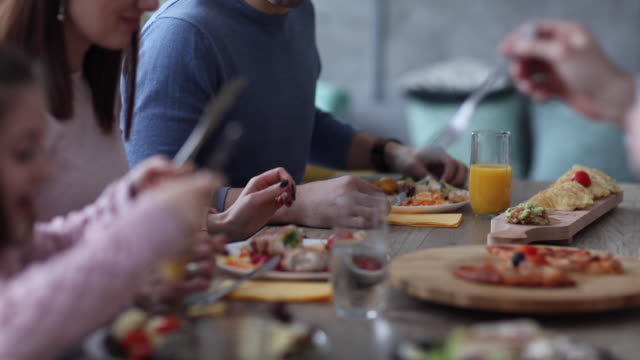family having lunch together - lunch stock videos & royalty-free footage