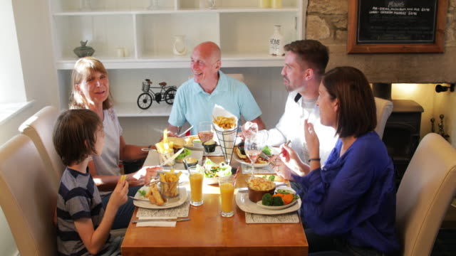 family having lunch - 35 39 years stock videos & royalty-free footage