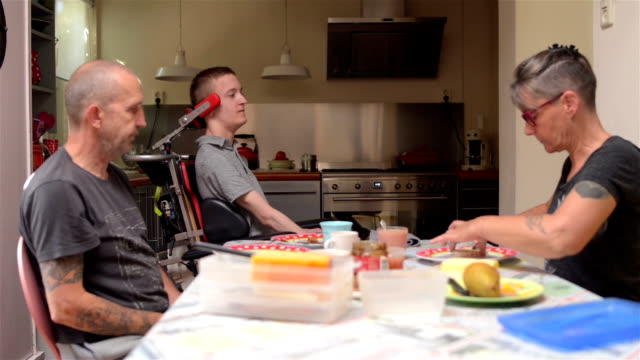 family having lunch with disabled son - physical disability stock videos & royalty-free footage