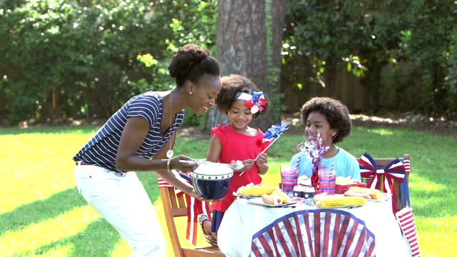 family having memorial day or 4th of july picnic - pacific islander family stock videos & royalty-free footage