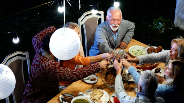 family having thanksgiving dinner. - dining table stock videos & royalty-free footage