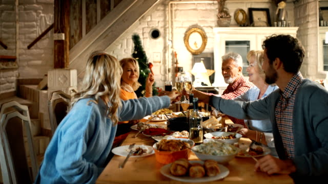 family having thanksgiving dinner. - abundance stock videos & royalty-free footage
