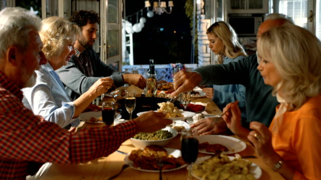 family having thanksgiving dinner. - dinner party stock videos & royalty-free footage