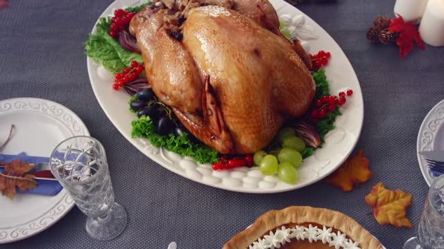 family having traditional holiday stuffed turkey dinner - roast turkey stock videos & royalty-free footage