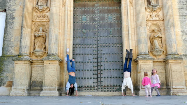 family headstand in church de san pedro church - famous place stock videos & royalty-free footage